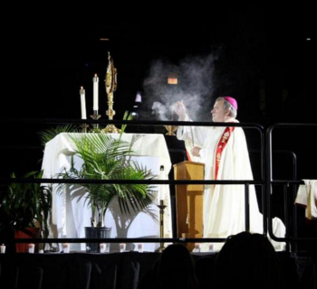 Bishop Manz incenses the Blessed Sacrament on the altar